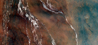waterfall mirage in the desert,abstract landscapes of deserts of Africa,Abstract Naturalism,abstract photography deserts of Africa from the air,abstract surrealism,water springs