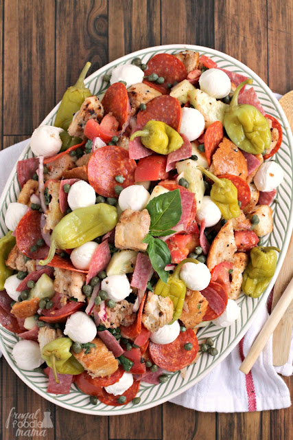 Two classic Italian salads are combined into one in this delicious Antipasto Panzanella Salad that's perfect for backyard BBQ's & potlucks.