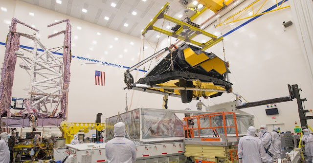 With all flight components under one roof, technicians and engineers work to prepare the two halves of the James Webb Space Telescope for continued testing and eventual assembly in 2019. Credits: Northrop Grumman