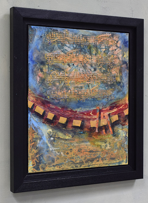 Musical score, texture, blue, green gold and red