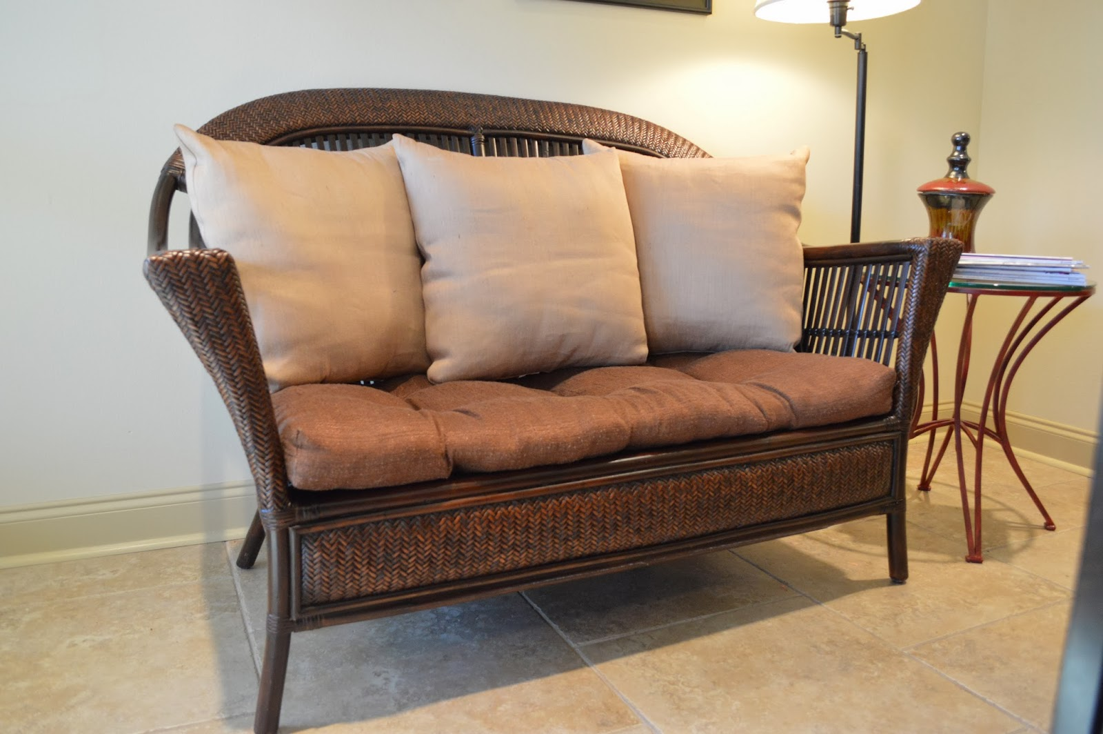 wicker chair cushions pier one card table and padded chairs moving sale rattan loveseat with cushion pillows 250