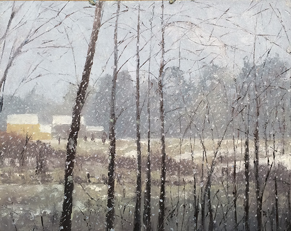 landscape with falling snow against dark trees in foreground, fields, houses, and trees in background.