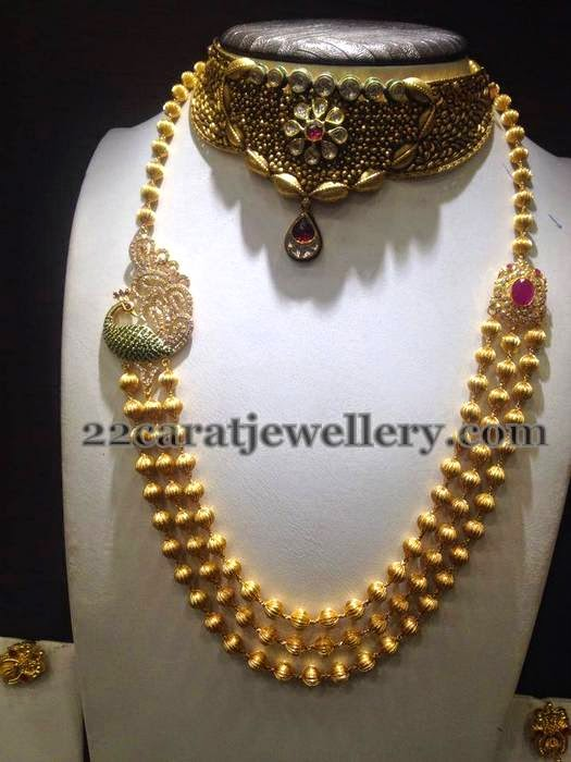 Gold Beads Set With Peacock Motif Jewellery Designs