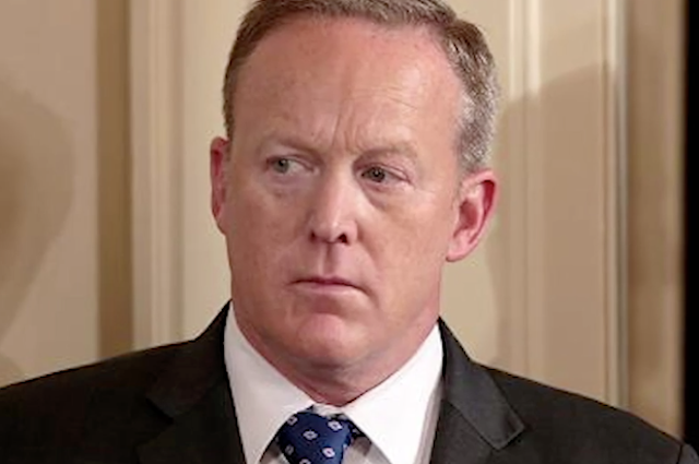 Spicer threatens legal action over AP report