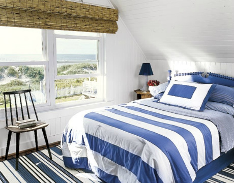 Blue and white coastal stripe bedding , blue painted cottage style headboard makes for a great nautical feeling bedroom