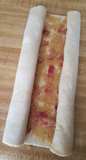rolled pastry with bacon and brown sugar