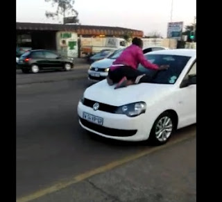 Watch Viral Video Of Woman Climbs Husband's Car On Motion Carrying Girlfriend ...Then This Happened