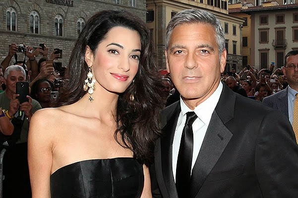 George Clooney and Amal Alamuddin at a charity event in Italy