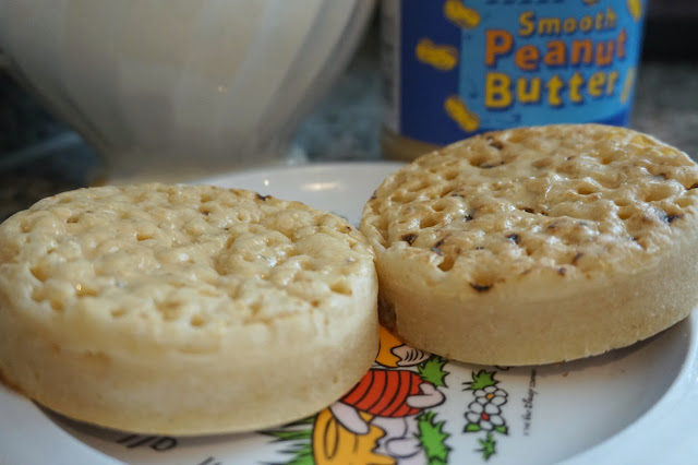 two crumpets with peanut butter