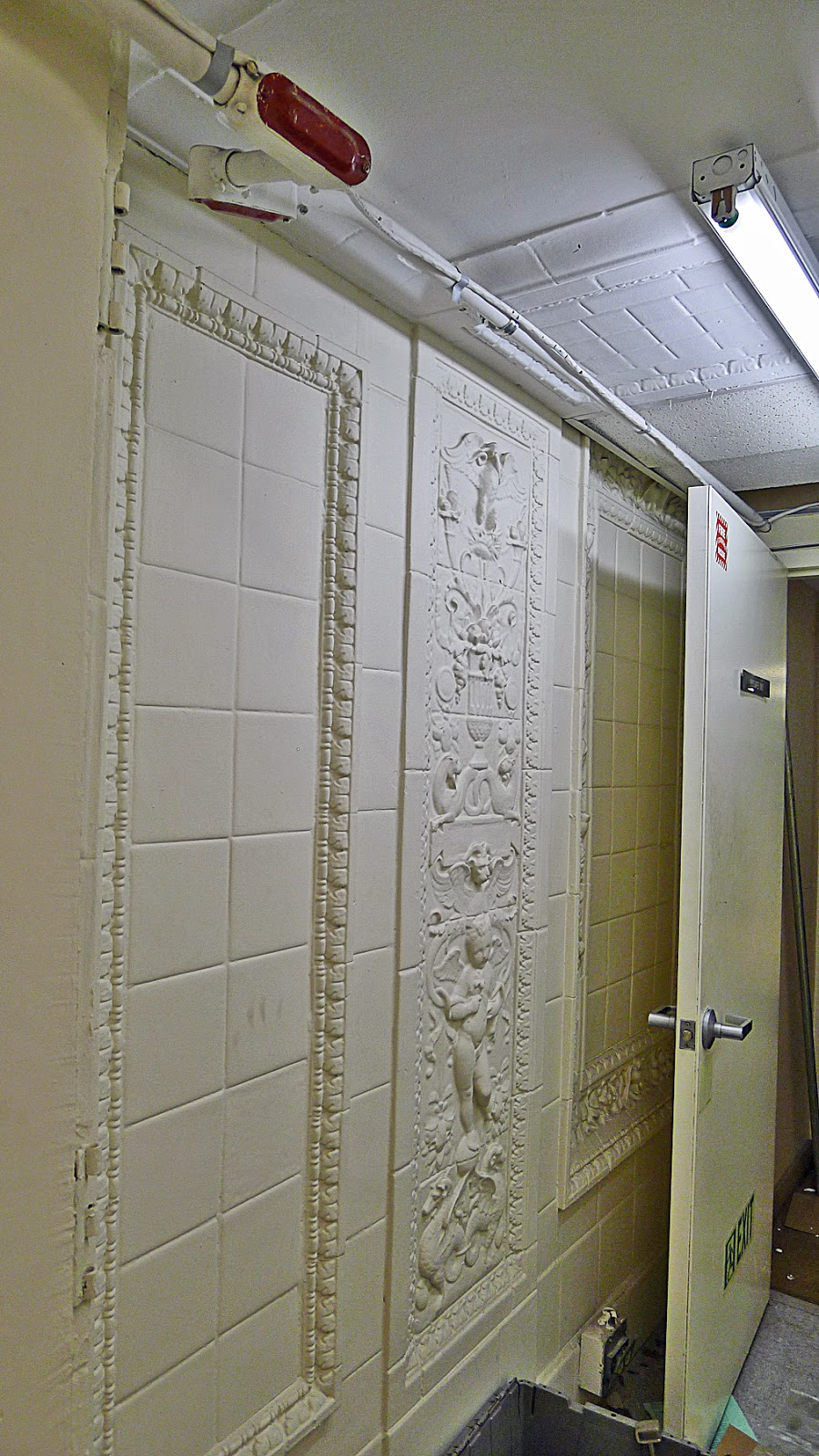 Installed bronze like tile on the weeping wall it looks old school - A 7 6 High Rookwood Faience Pilaster Wall And Ceiling Tiles And Faience Border Decoration