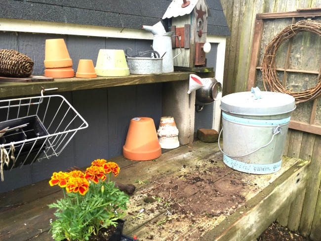 Potting table with flowers and pots