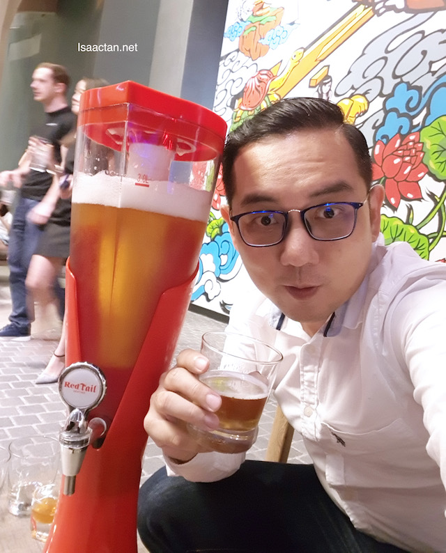 Isaac tan with tower beer
