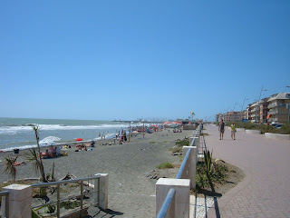 The beach at Ostia Lido attracts many visitors from nearby Rome during the summer months