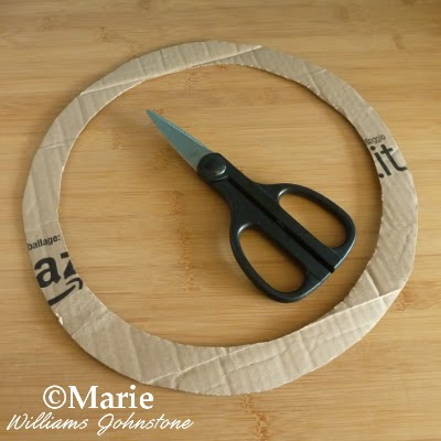 Circle of thick card from box with scissors