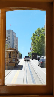 Inside a cable car heading up Powell St.