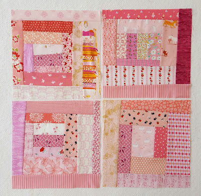 four pink log cabin blocks