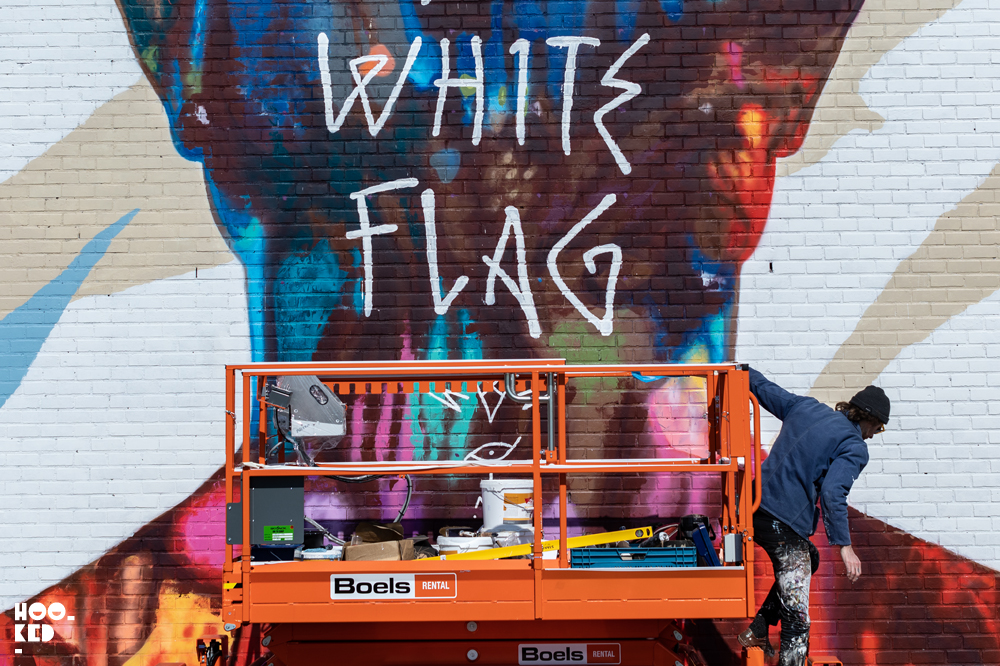 Artist David Walker at work in a scissor lift in Ostend