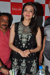 Kajal Aggarwal in lovely Black Sleeveless Anarlaki Dress in Hyderabad at Launch of Bahar Cafe at Madinaguda 014.JPG