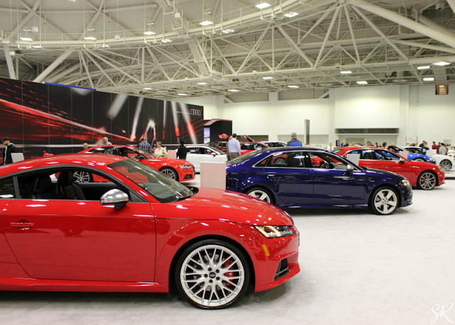 Audi red and blue cars at the Twin Cities Auto show