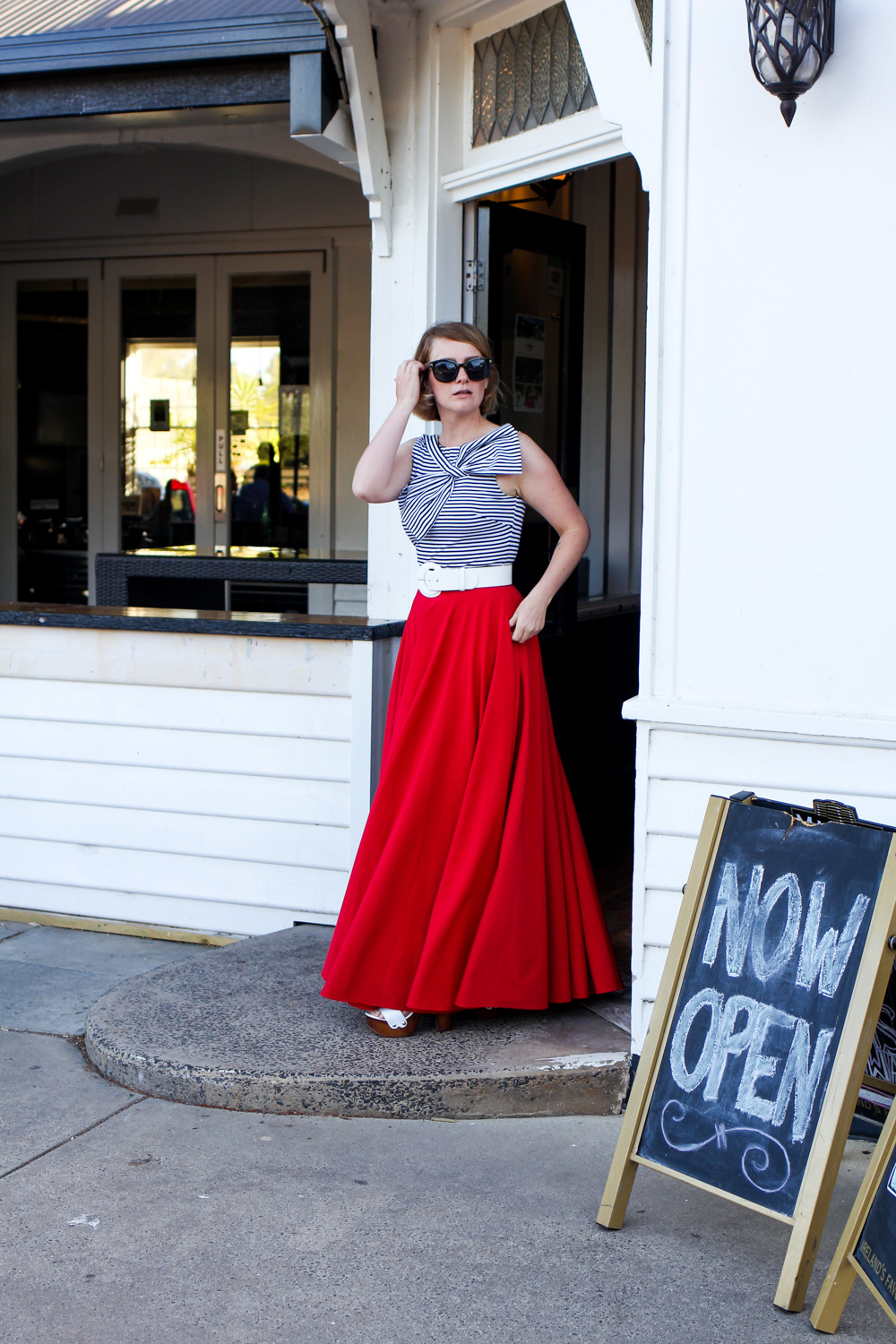 @findingfemme wears Mokkafiveoclock red full circle maxi skirt.