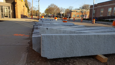pile of curbing to be used along Main St