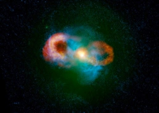 A composite image of the galaxy Cups of tea, green color shows the starlight, blue indicates gas and yellow / red shows the radio emission. Bright yellow blob in the middle of the picture is the radio jets are launched by the black hole, the gas accelerates to a speed of 1000 km / s (200,000 miles per hour). This giant bubble also is expanding by the black hole center of the galaxy. This suggests that the black hole at the center of the galaxy to bring disastrous effects on the parent galaxy.