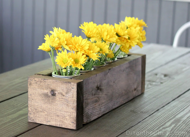 Scrap Wood + Mason Jar Centerpiece via DIYontheCheap.com