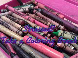 A pink plastic box filled with crayons.  Words across image say: Stressed? Take a Coloring Break
