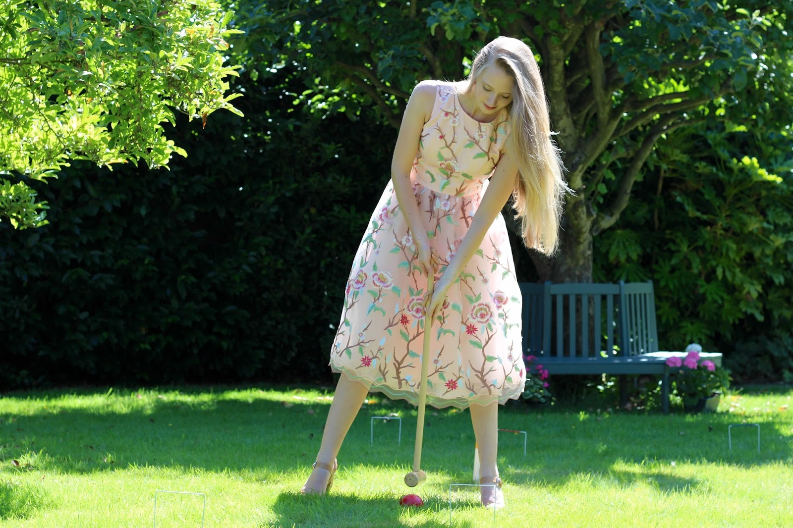 Game of croquet in Chi Chi dress