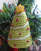 http://www.ravelry.com/patterns/library/beaded-christmas-trees