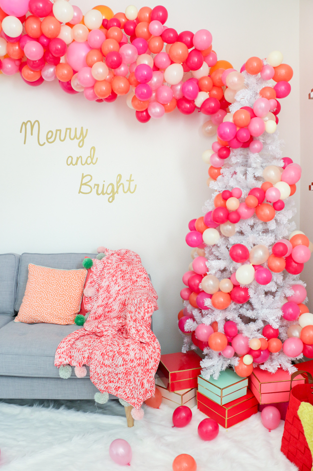Throw the best, most colorful bubbly Christmas party complete with a balloon filled tree and bubbly bar cart. Holiday party ideas - Christmas party decorations - DIY party decorations
