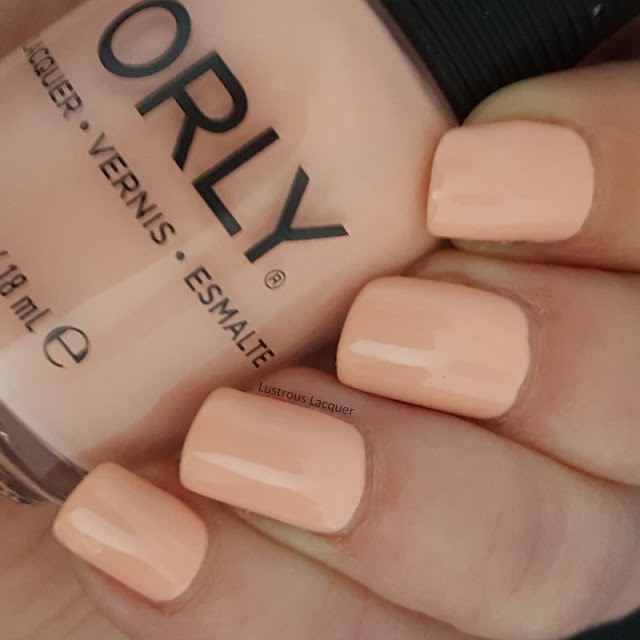 Pale peach nail polish with a pink undertone and a creme finish from the Pastel City Collection