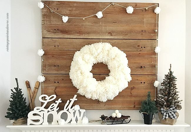 Vintage Paint and more... a winter mantel done with a diy yarn pom-pom wreath and garland and rustic winter decor pieces