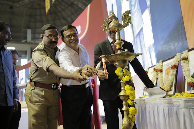 Lighting of Lamp by Asst. Commnr. of Police Narayan Swamy