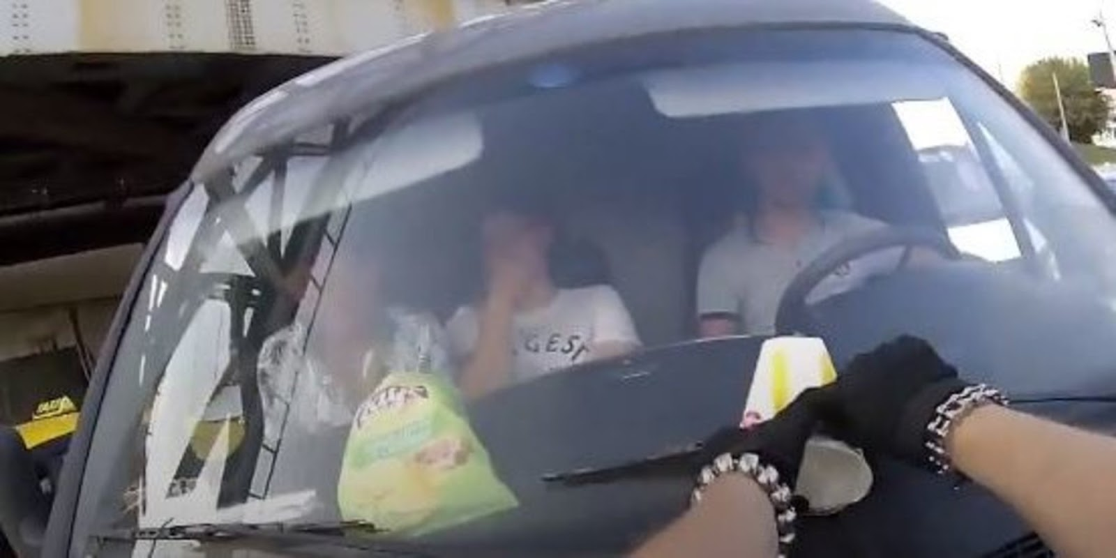 Thought-Provoking Video Shows Biker 'Returning' Trash To Irresponsible Driver