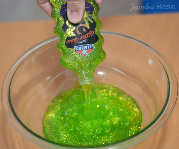 Bring a cherished Christmas movie to life with this easy to make Grinch slime for kids. #grinch #grinchactivitiesforkids #grinchcrafts #grinchslime #grinchslimerecipe #grinchslimekids #grinchslimediy #christmasslime #holidayslime #slimerecipe #slime #growingajeweledrose #activitiesforkids