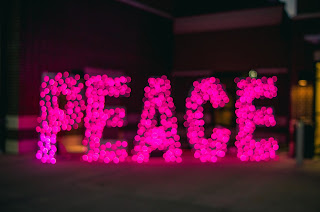 Restoring broken fellowship - image of pink peace letters
