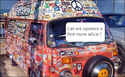 VW camper van covered in badges with speech bubble Can we squeeze a few more ads in?