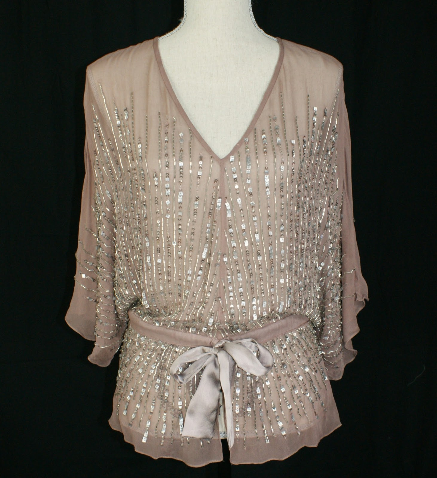 Plus Size Beaded Tops So no matter if you need one for an elegant event or you just want to dress up your jeans, there is a great selection available. Beaded and Sequined tops are available as formal wear, to wear with an elegant skirt or plus size special occasion or palazzo pants.