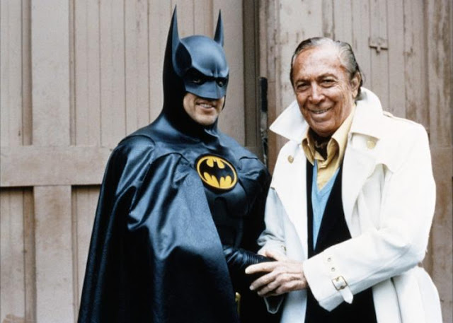 Bob Kane posing with the Caped Crusader, Kane's iconic creation, Batman