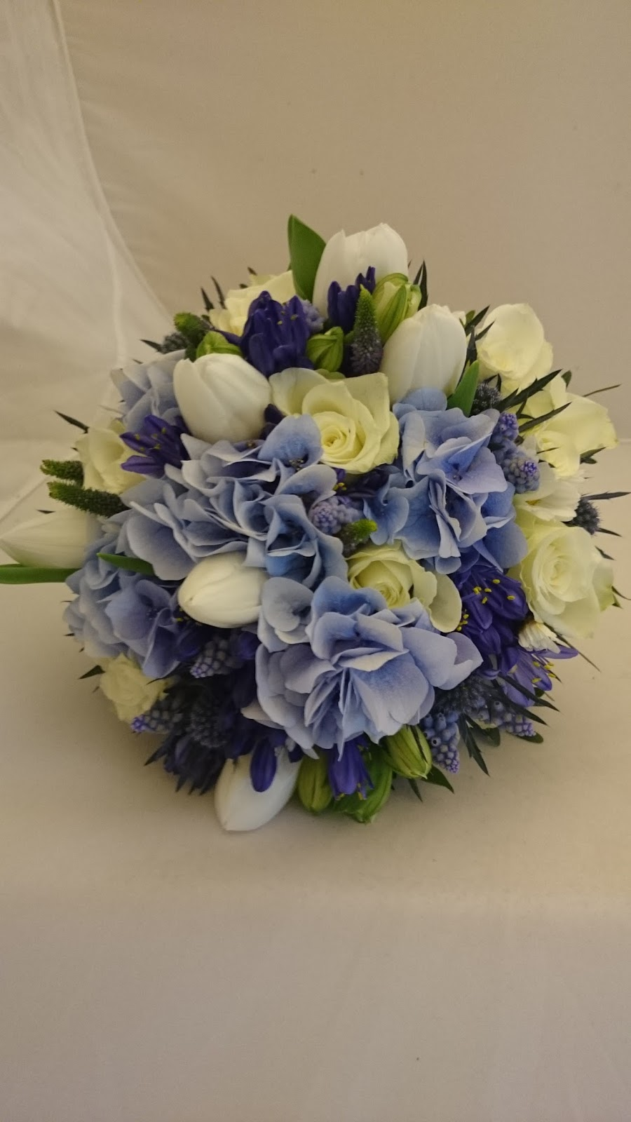 Flowers Included White Tulips And Alstroemeria Small Ivory Roses Blue Hydrangea Muscari Thistle Agapanthus Veronica