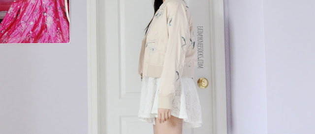 Golden-beige long sleeve cropped floral silky satin bomber jacket from Romwe, featuring floral embroidery, front pockets, and a gorgeous silk-like souvenir jacket-esque fabric.