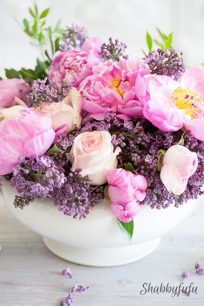 beautiful lilac and peony centerpiece