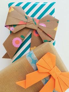 come fare dei fiocchi origami per regali di natale