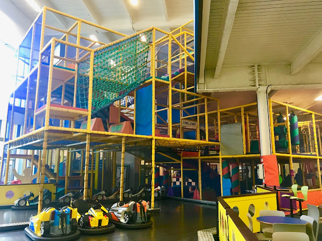 A view of a 4 story soft play frame with dodgems in the foreground