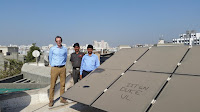 Duke Engineering Professor Michael Bergin (Left) Stands with Indian Institute of Technology-Gandhinagar Colleague Chinmay Ghoroi (Right) Next to that University's Extremely Dusty Solar Panel Array (Credit: Michael Bergin, Duke University) Click to Enlarge.