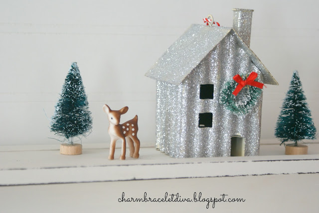 Darling miniature deer beside glittered house and bottle brush tree