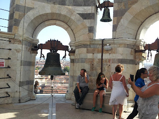 Tourists at the top of the Leaning Tower of Pisa