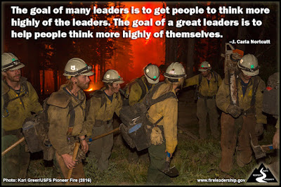 The goal of many leaders is to get people to think more highly of the leaders. The goal of a great leaders is to help people think more highly of themselves. –J. Carla Nortcutt (Firefighters huddled around each other at night with fire burning in the background)