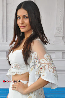Telugu Actress Amyra Dastur Stills in White Skirt and Blouse at Anandi Indira Production LLP Production no 1 Opening 0029